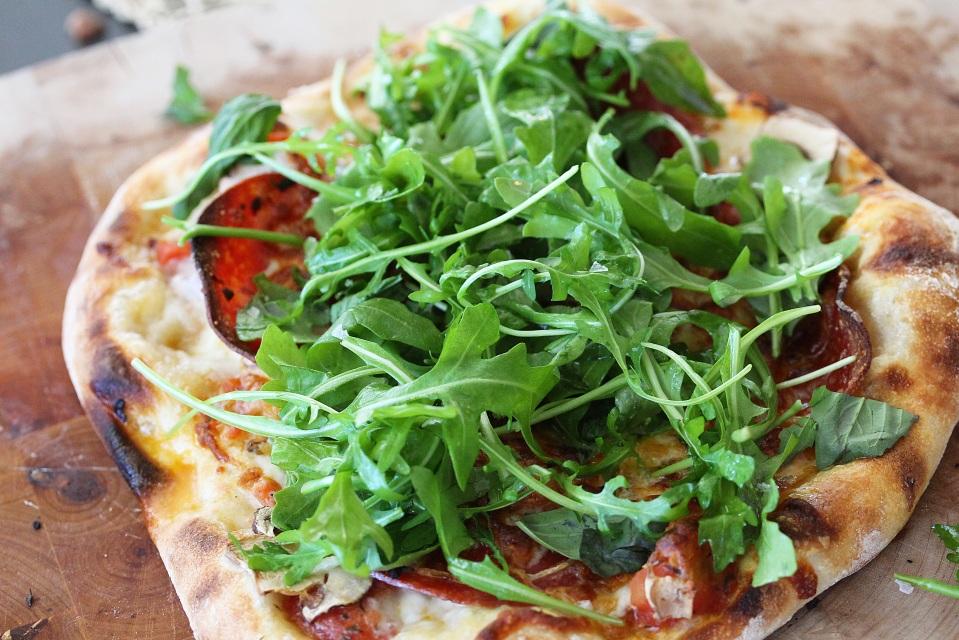 Pizza with arugula salad